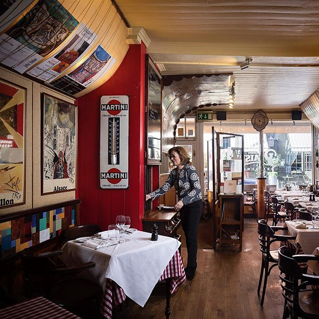 Marilène first came over from Nantes in west France in 1987 and began working for @monplaisirrestaurant in Covent Garden the year after. These days she deals with all the accounting and financial side of the business and helps out front of house in the evening. This is the original dining room that was almost completely destroyed in a fire in 1998 - the owners painstakingly restored it using old photos, even salvaging the smoke-damaged vintage posters.  Marilène tells me wonderful tales of regulars over the years: 'One couple came to Mon Plaisir on their first date, he proposed here, they had their wedding lunch here with a few friends and family, and returned a year or two ago to celebrate their 50th wedding anniversary!' Head to the website for more on Marilène. . — Long Service: London is a photography project about London's restaurants and cafes and their longest-serving members of staff, with a view to becoming a coffee table book at some point. The response has been fantastic so far and many venues are keen to be involved. I'll be posting some of the final portraits, details, exteriors, and behind the scenes images from the project over the coming weeks and months. — . Please follow, share, spread the word and get in touch if you'd like to be involved! longservicelondon.com