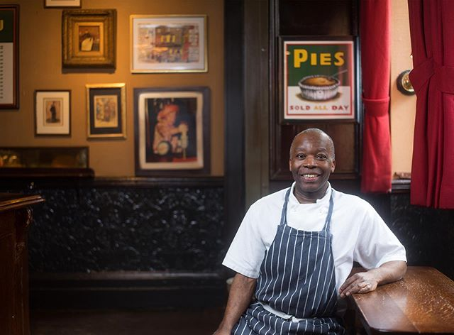 "I had the pleasure of meeting and photographing the charismatic Manisulu the other day. He arrived in London from Uganda in 1990. ""I just came over here on holiday! And stayed by default."" He started working in Mayfair's Guinea Grill (@guineagrill) in 1995 and can still be found either in the kitchen or outside guarding the pub's door. I ask if the place has changed much over the years. ""Absolutely. We used to be busy but now it's madness!"" More on Manisulu on the website soon. . — Long Service: London is a photography project about London's restaurants and cafes and their longest-serving members of staff, with a view to becoming a coffee table book at some point. The response has been fantastic so far and many venues are keen to be involved. I'll be posting some of the final portraits, details, exteriors, and behind the scenes images from the project over the coming weeks and months. — . Please follow, share, spread the word and get in touch if you'd like to be involved! longservicelondon.com"