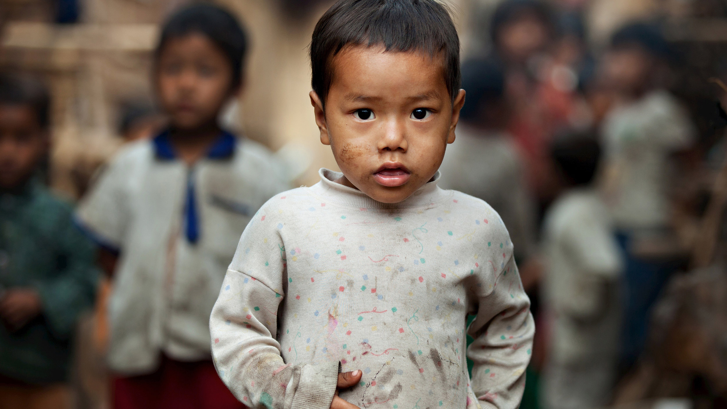 Boy in alley in Burma.  Photo courtesy Silent Images
