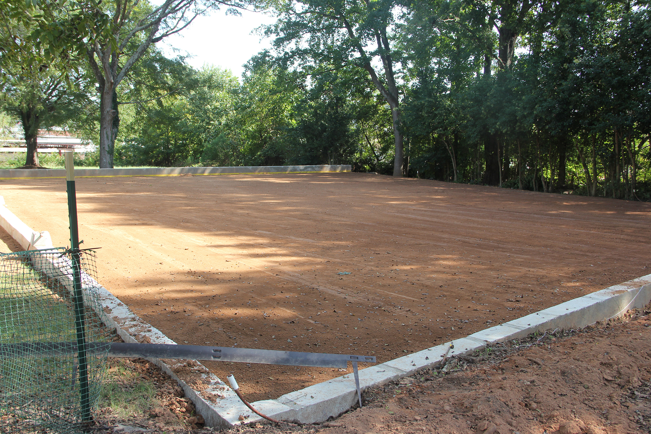 Tofano has a leveled and compacted area in his backyard prepared for a full-sized bocce ball court.