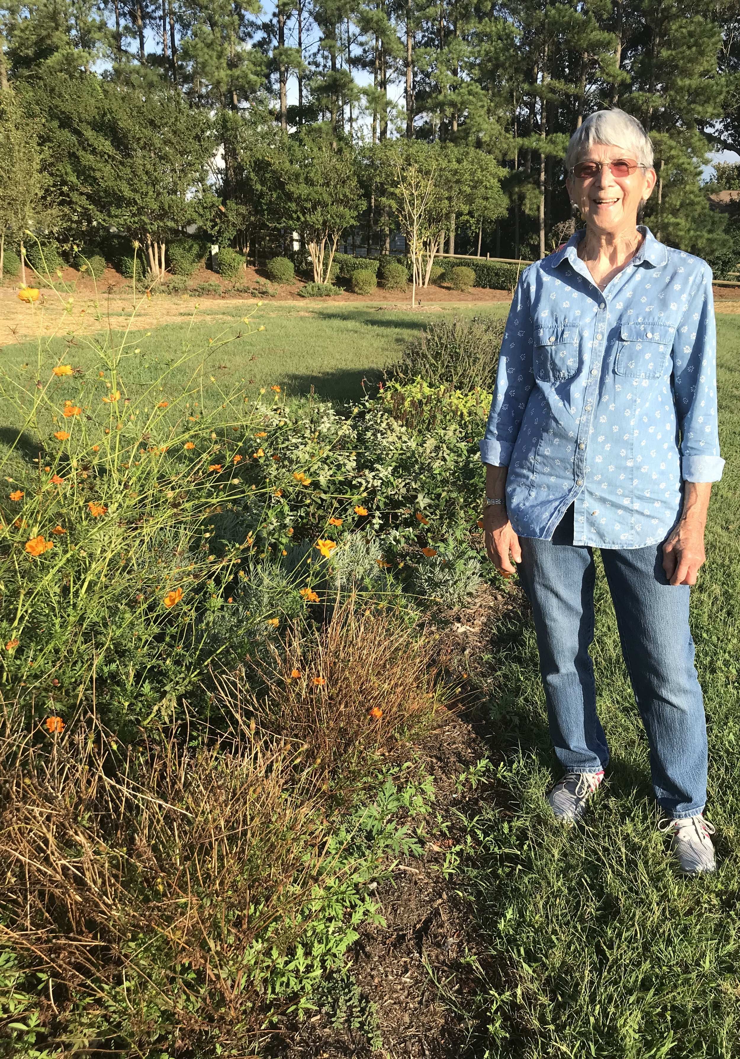 Martha Krauss stands among the pollinator plants at Country Place Pocket Park.  Photo by Cyma Shapiro.