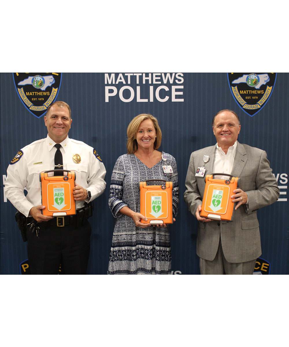 "News About Town: The Town of Matthews recently purchased 11 new Cardiac Science G5 Defibrillators for the Automated External Defibrillator (AED) Program, thanks to a $15,000.00 grant from Novant Health. The older defibrillators these replace were heavier with outdated parts. ""When Novant Health found out that we were looking at ways to start upgrading our AEDs, they immediately asked how they could help,"" said Matthews Police Chief, Clark A. Pennington. ""It's such an overwhelming feeling when you have community partners that are willing to help provide lifesaving equipment to our officers. We all benefit when our officers have the best tools possible."" Novant stated it's crucial for these machines to be available for police in emergency response roles. Accessibility and response time dramatically increase chances of survival for a person who experiences sudden cardiac arrest. -"