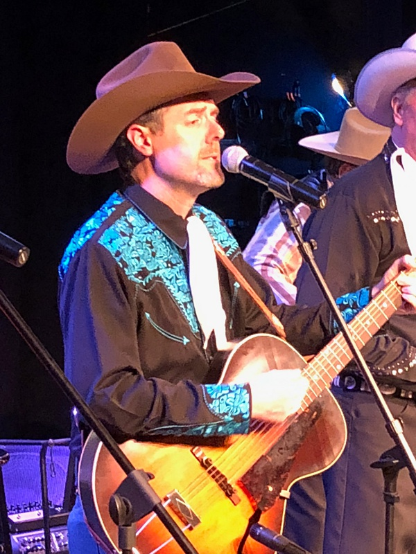 At the Gaslight Theater in Oro Valley AZ. Either John's yodeling or Ken's standing on his foot.