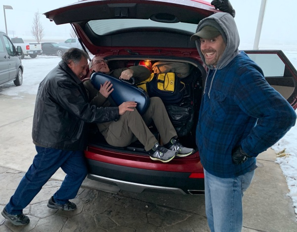Tommy and John packing Paul for the airport trip on the last morning of our southwest/midwest tour.
