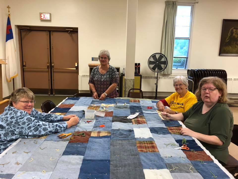 ELCA Day of Service - Good Hope and Zion members work on a quilt to be donated to the needy, September 2018.