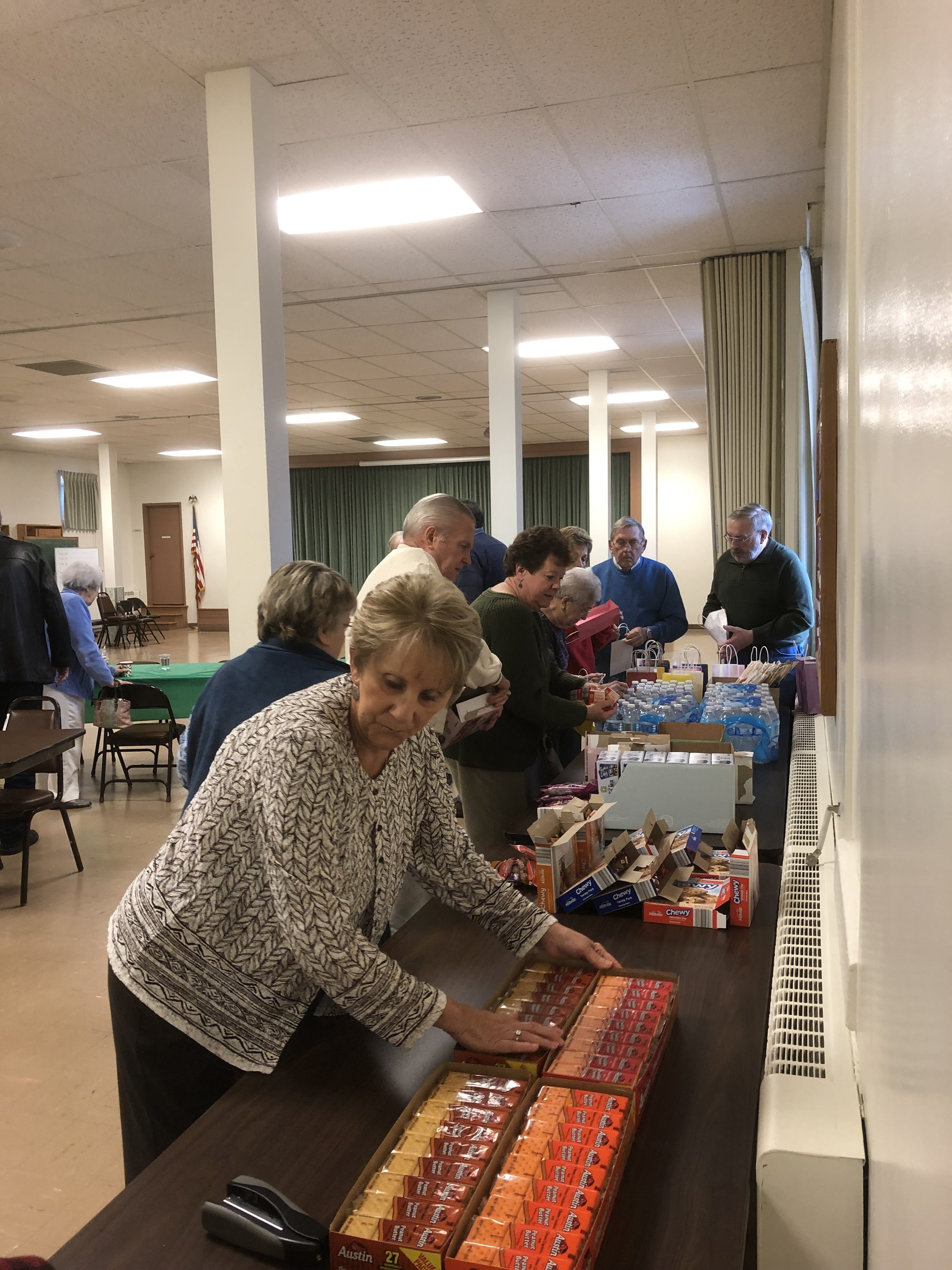 Church members putting together Bags of Love for people in need. Part of Worship on Wednesday activities on December, 2018. (photo Pastor Parsh)