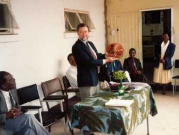 Paul being presented with a traditional copper plaque of Zambia from the Ministry of Health during his farewell party.