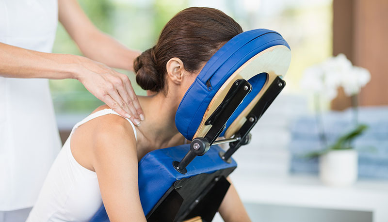 Chair/Event Massage  Chair massage is a seated treatment targeting neck, back, & shoulders and is a great way to work out muscle tension on the go or boost attendance and atmosphere of any event.