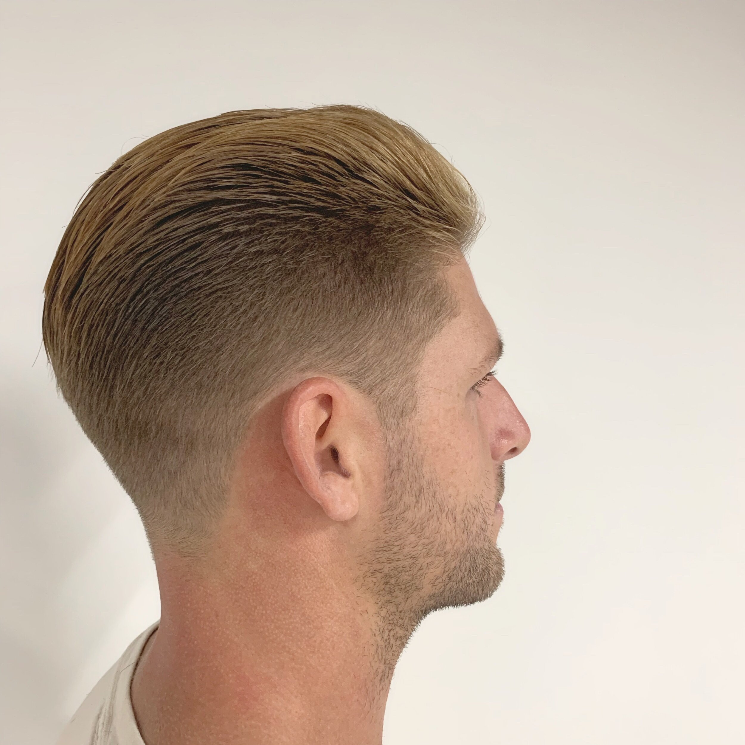 - Hayden owns the shop and specializes in traditional haircuts