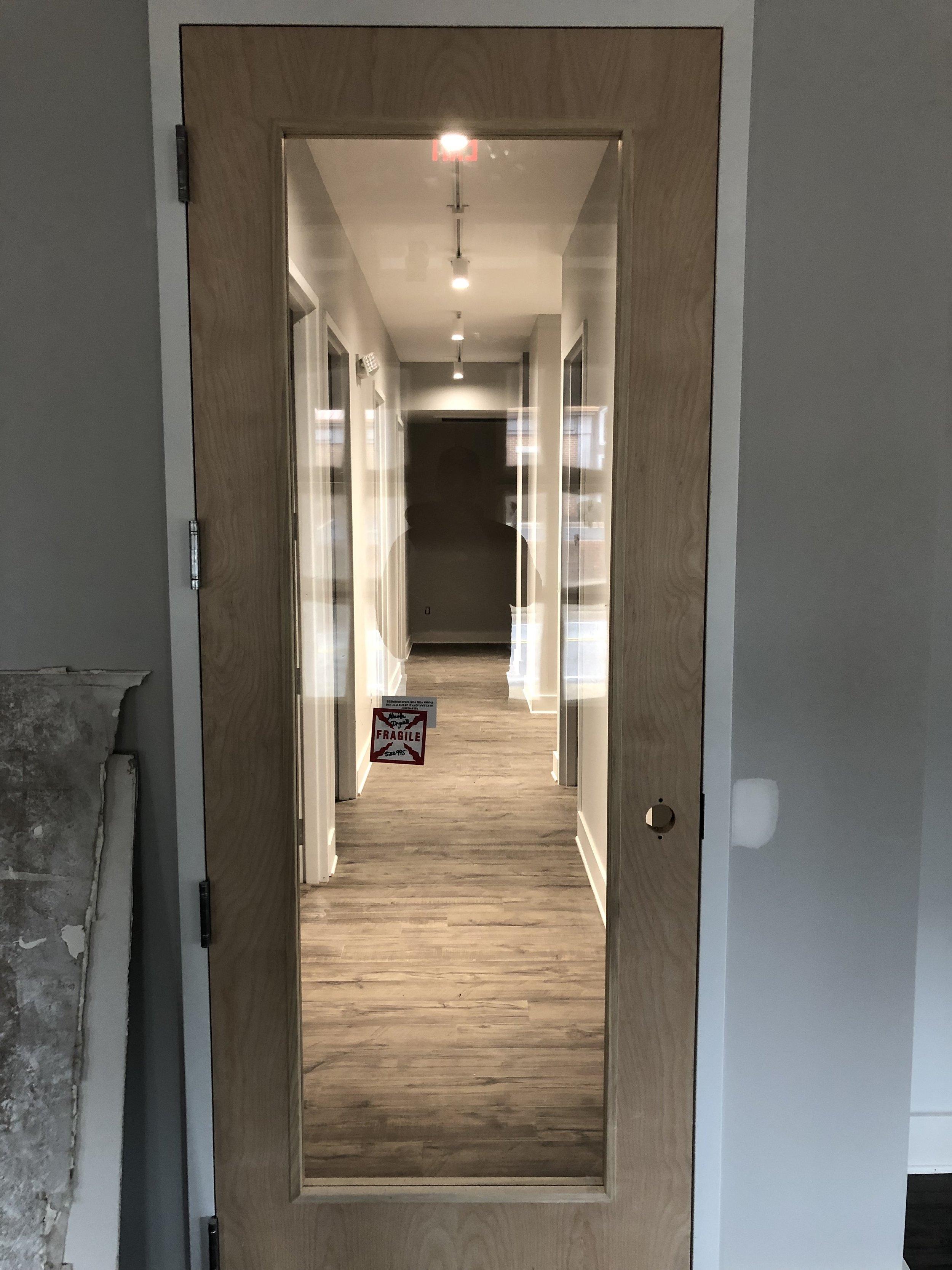 Glass door installation at start of hallways.