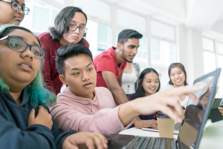 students-surrounding-computer.jpg