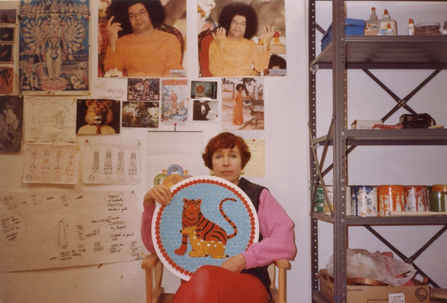 above: Joan Brown in her studio (photographs of Sathya Sai Baba hanging in the background), 1990. © The Joan Brown Estate. Photograph courtesy of The Bancroft Library, University of California, Berkeley.