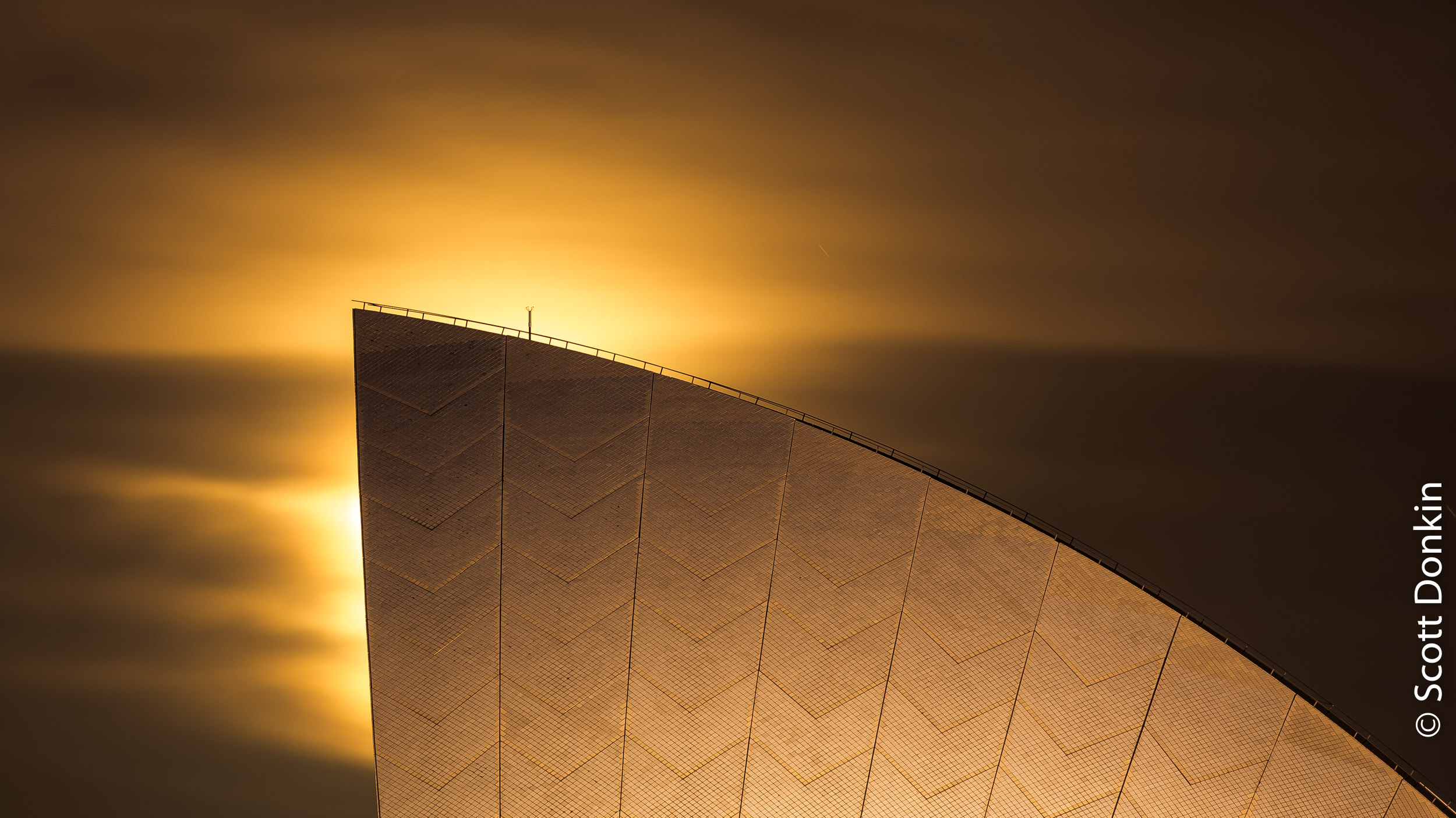 """Sail of the Sydney Opera House against a rising Perigee (""""Super"""") Moon. 15 November 2016."""
