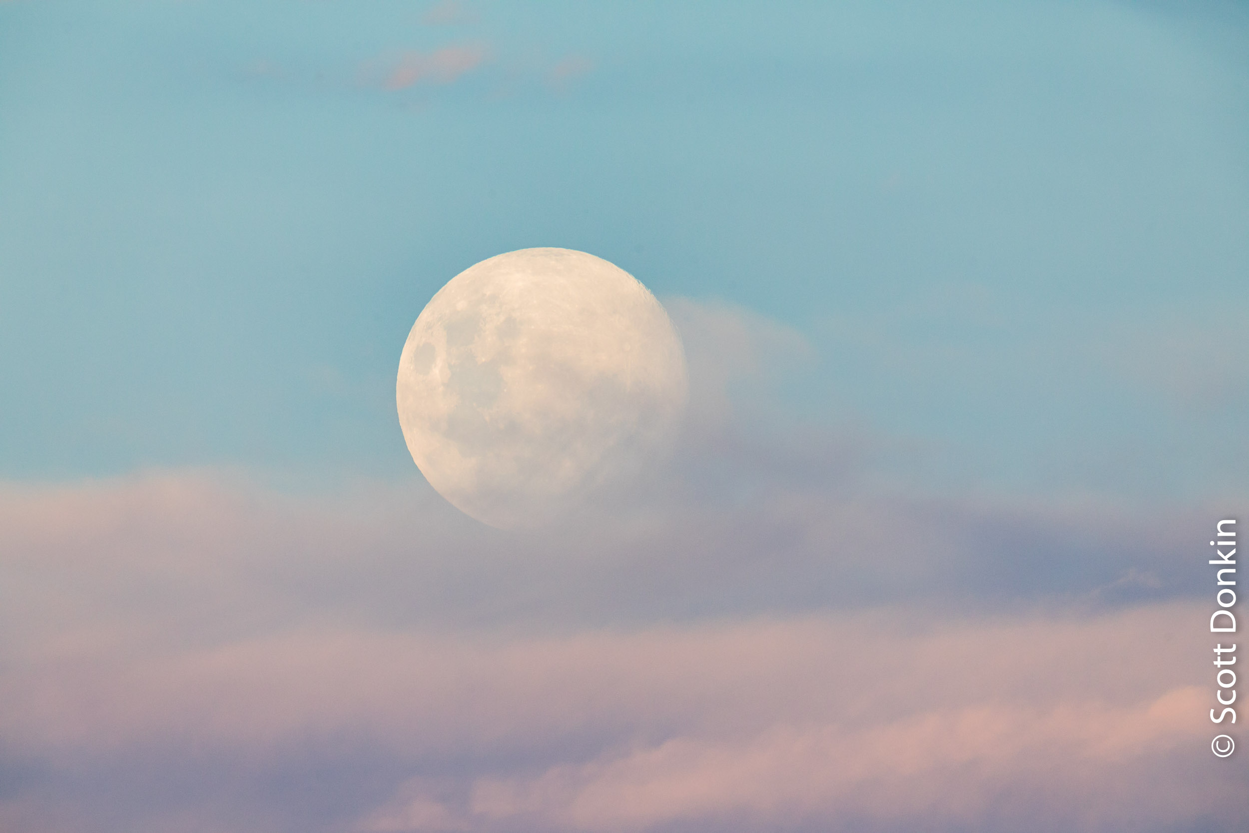 Rising full moon and clouds at dusk. Sydney.