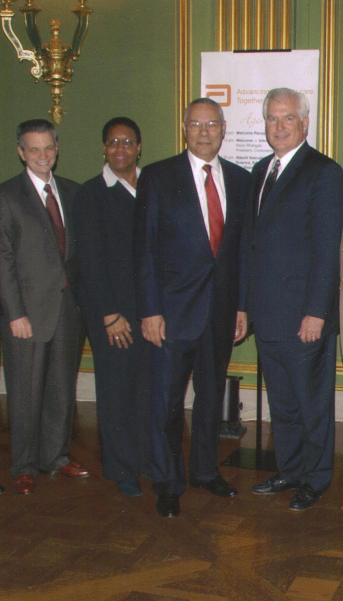 Sandra Burke with General Colin Powell & Abbott Top Executives, 2006.jpg