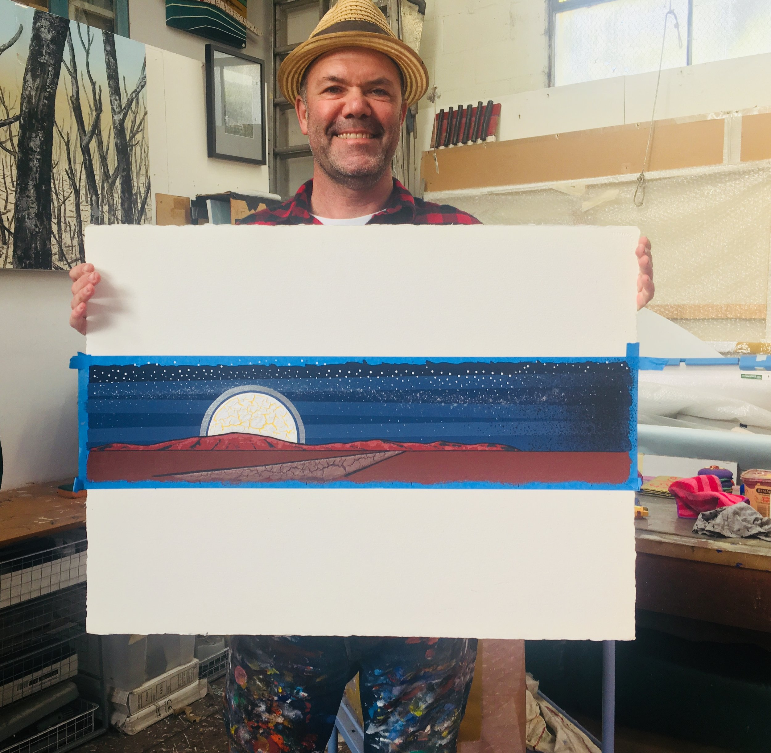 Collaborator and celebrated artist Blak Douglas with the original artwork created for the audience gift booklet as part of MWTIN engagement strategy