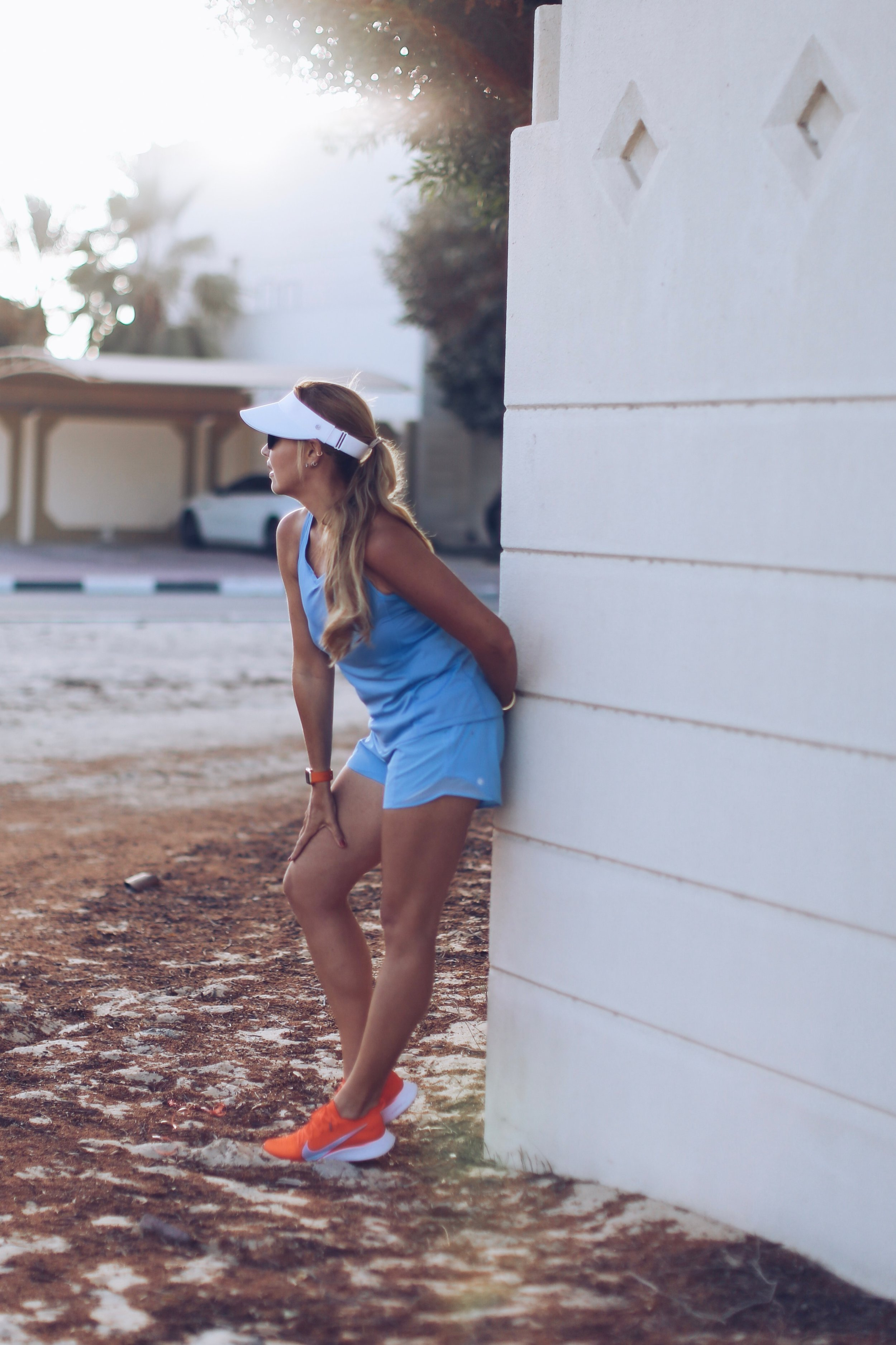 Visor by Lululemon, top by Nike, shorts by Lululemon, watch by Apple Watch and sneakers by Nike