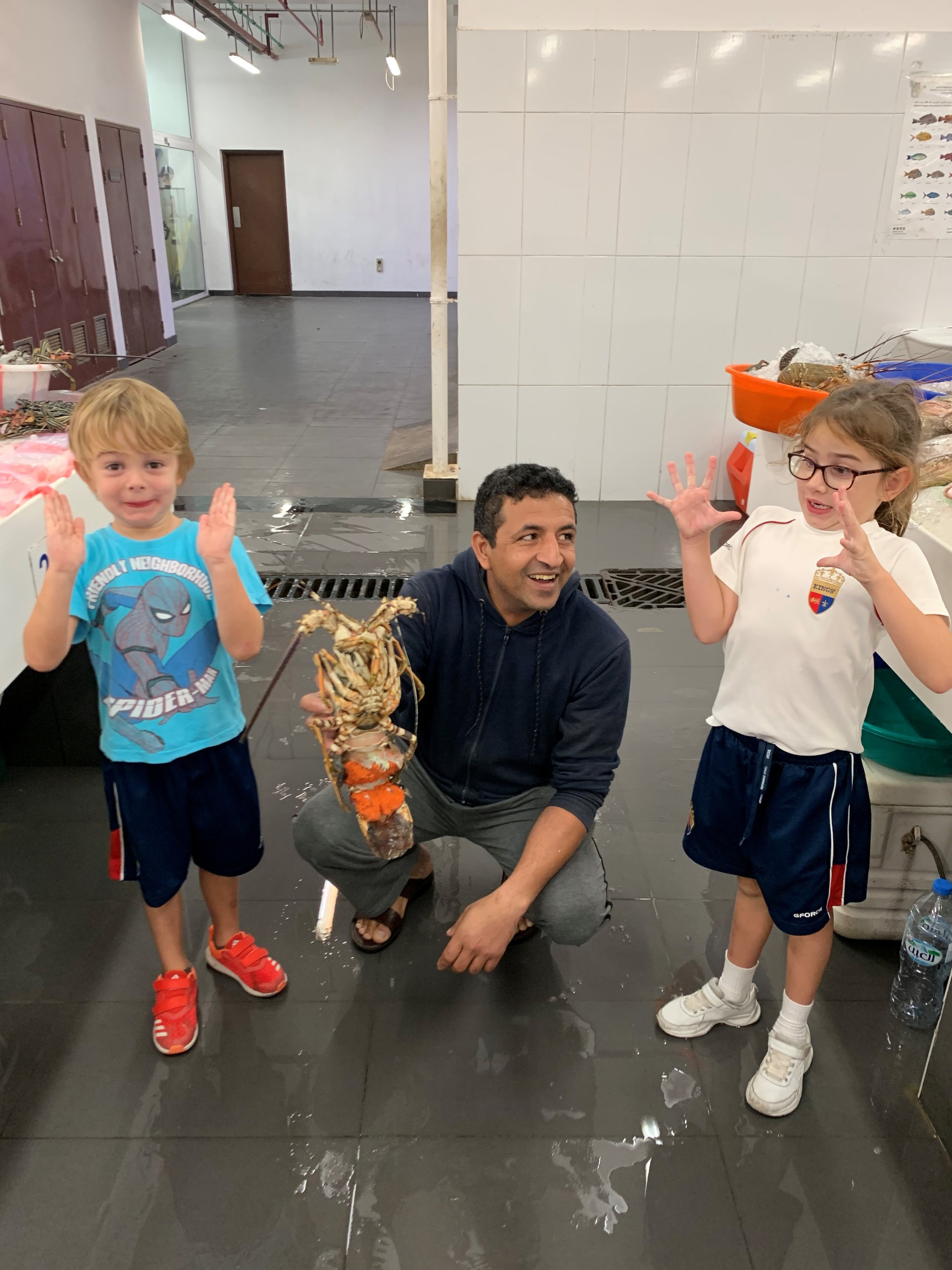 Fox and Leo rewarded with an ex-lobster at Jumeirah Fish Market following a sunset jog