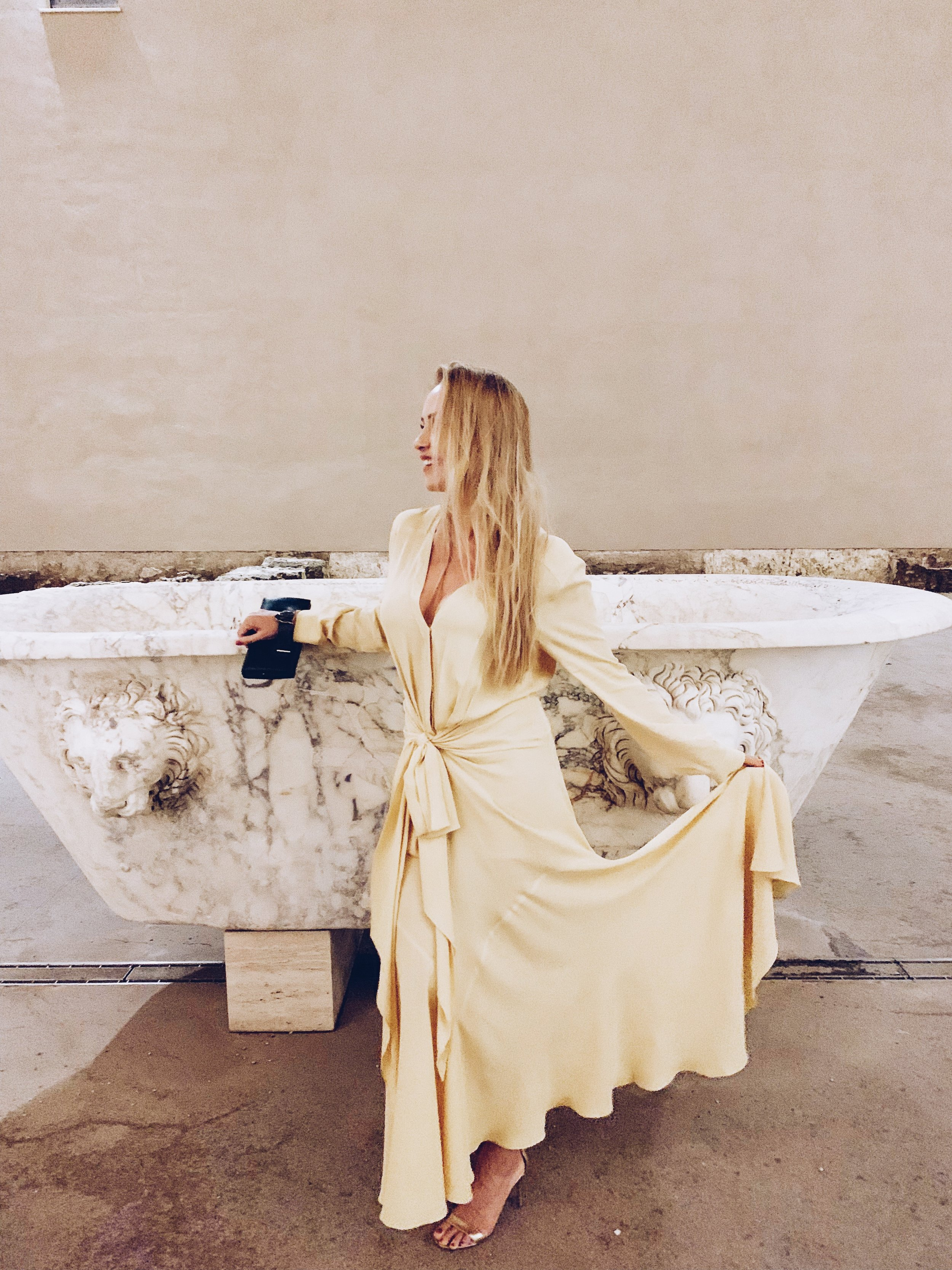 Rome's Diocletian baths wearing dress by  Jacquemus  at  Boutique 1
