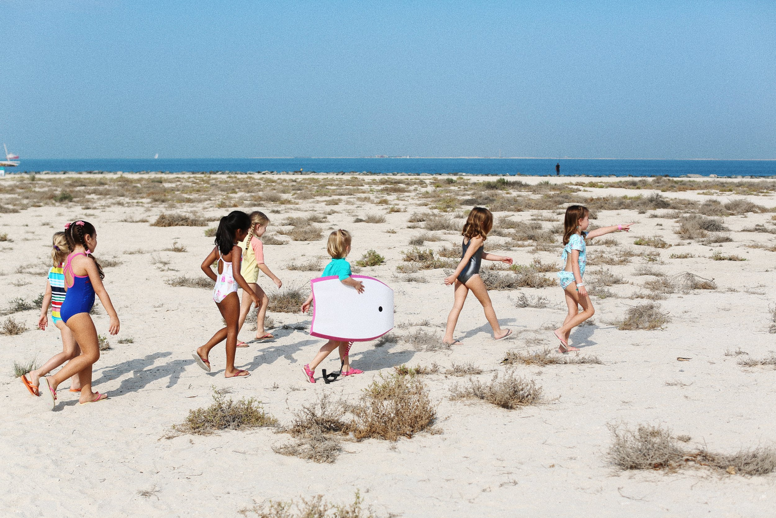 Leo and her friends heading to the sea at Dubai's Nessnass beach