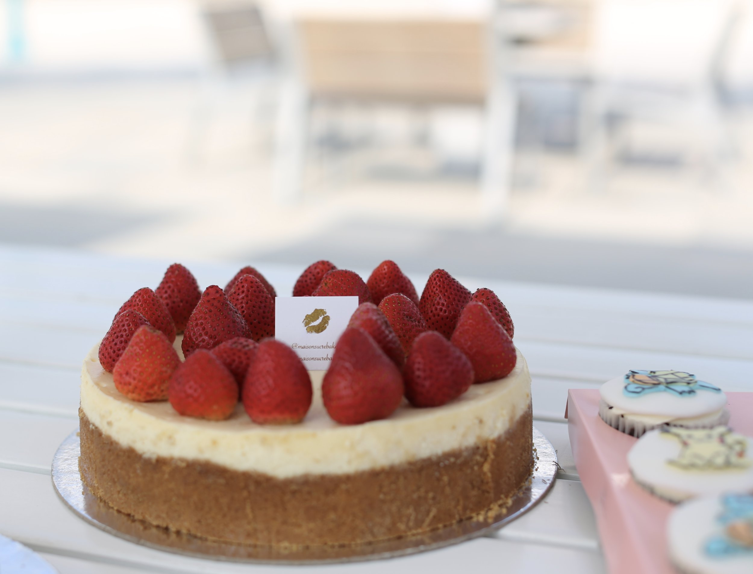 Maison Sucre 's delectable strawberry cheesecake for the parents