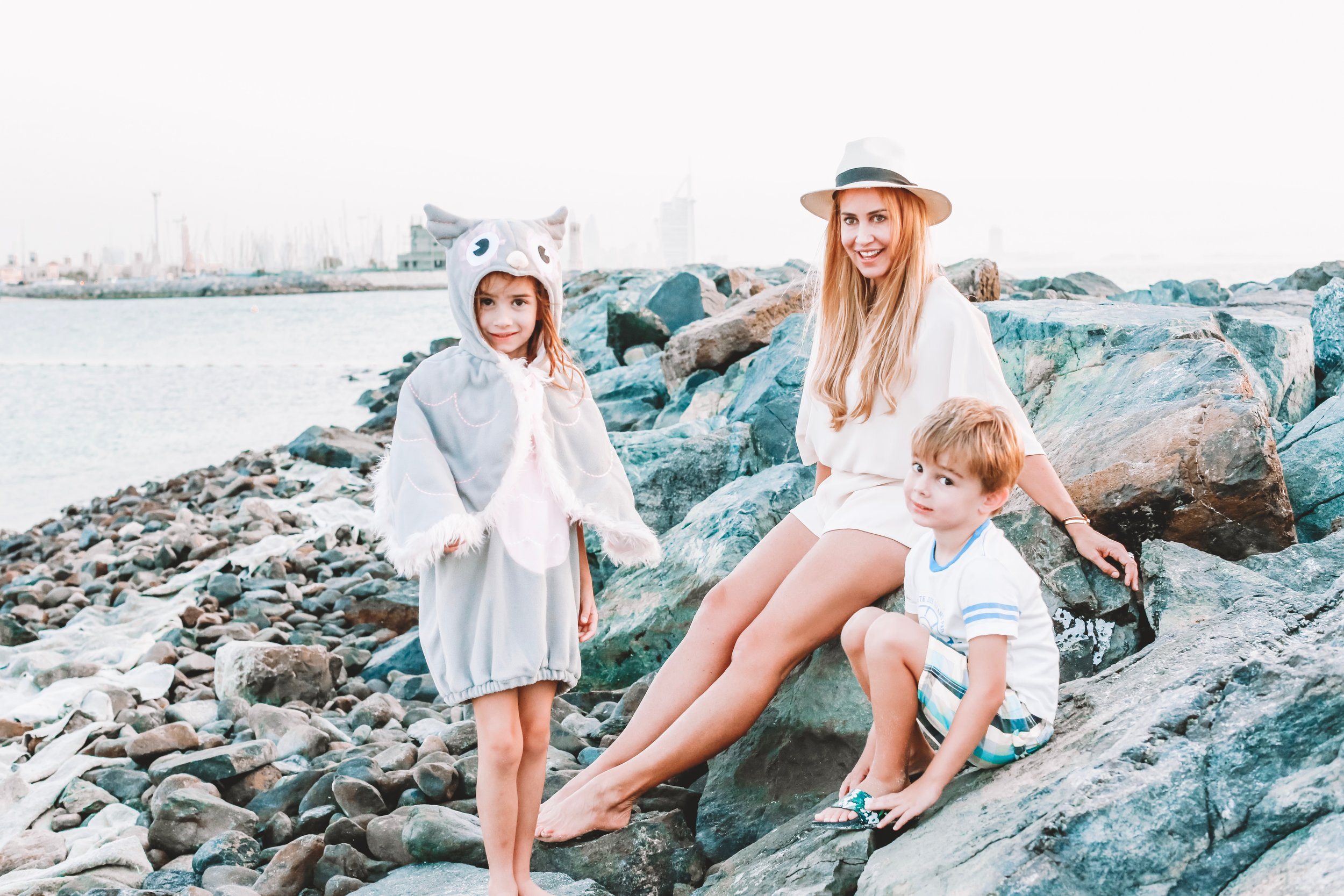 Leo in her owl  onesie , my fave beach  playsuit  and  fedora  and Fox wondering where the hell it all went wrong