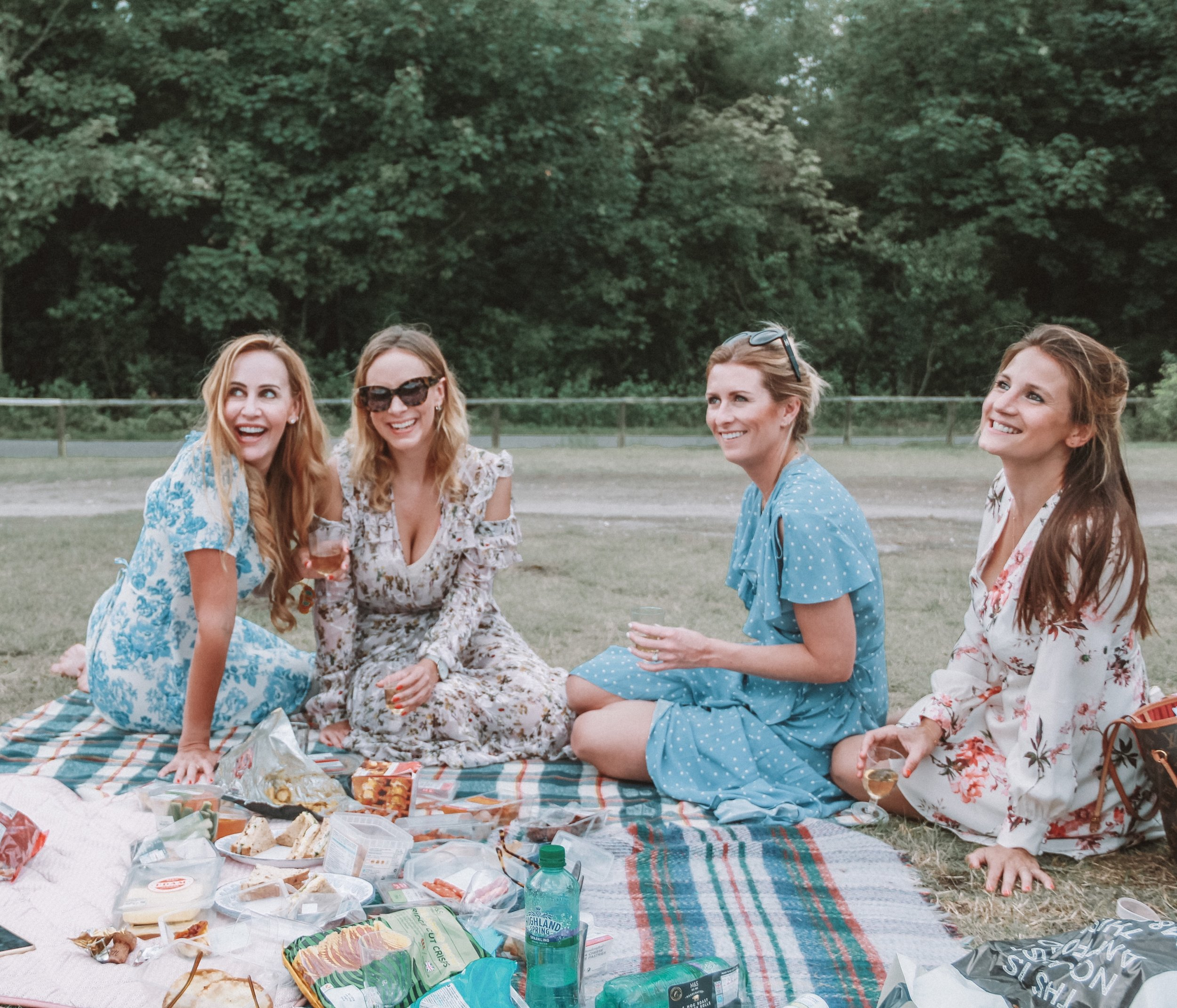 Me, my sister Lucy (in Preen) and sisters-in-law Cat (in Miss Selfridge) and Cath (in The Kooples) picnicking at Goodwood racecourse
