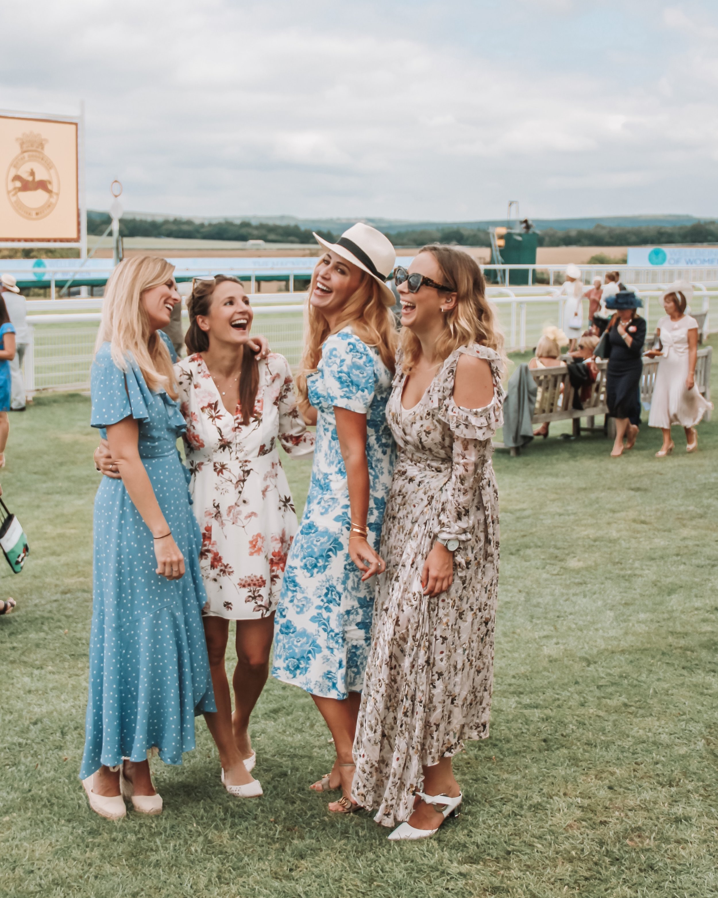 Cat, Cath, me and Lucy in floral frocks in the Richmond Enclosure for Ladies Day at the Goodwood Festival 2019
