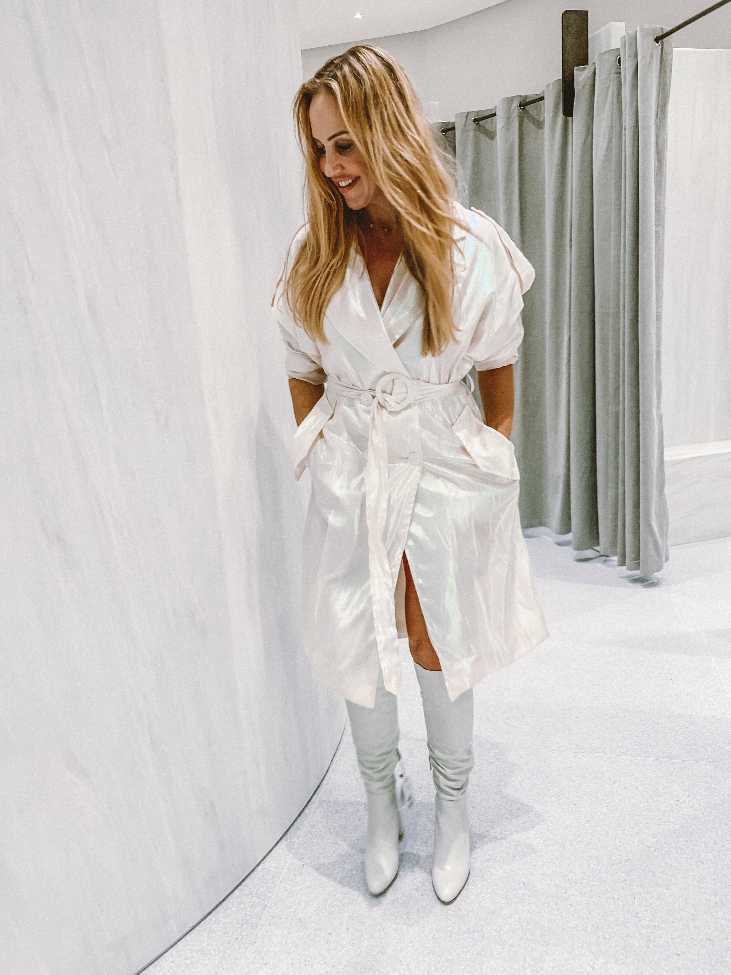 The iridescent trench and white boots that work better in the white marble changing rooms than in real life
