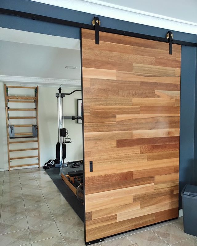 Barn door made with engineered blackbutt timber. Custom made by Sparks & Dust! ⚡️Thanks for the photo Jeremy! 👍  #customorder #canberradesign #sparksanddust #wearecanberra #canberracreatives #handmadeincanberra #interiordesign