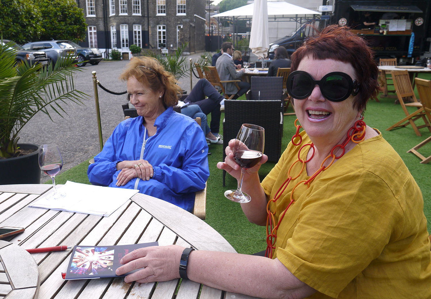 A good glass of wine and some stylish Prada sunglasses: now that's class!