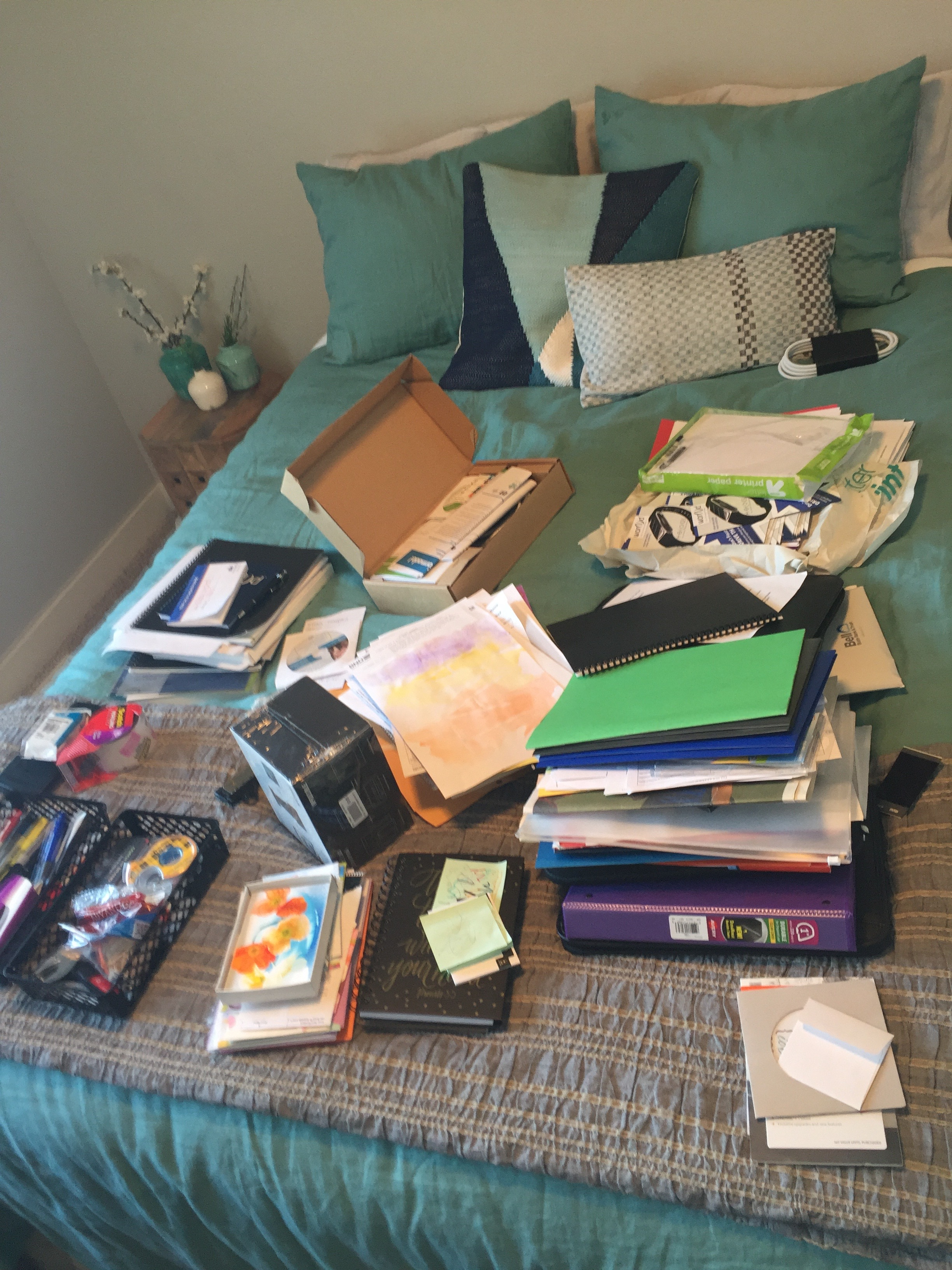 Get started by taking everything out of your desk and putting it in one area. (The top of a bed, or on the floor, work great!) Pick everything up and ask yourself if the item sparks joy or is useful.