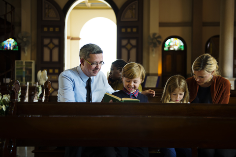 dreamstime_xs_97130516 © Rawpixelimages family at traditional church.jpg