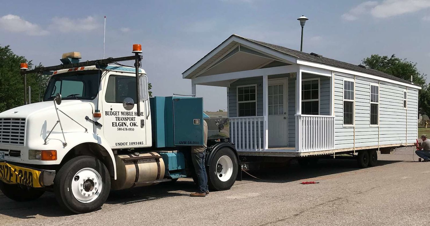 Budget Mobile Home Transport & Removal on mobile mini bar, temporary power pole installation, mobile home straps,