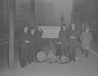 12-3-48_Mile_Of_Dimes_(5 men, 3 signs).jpg