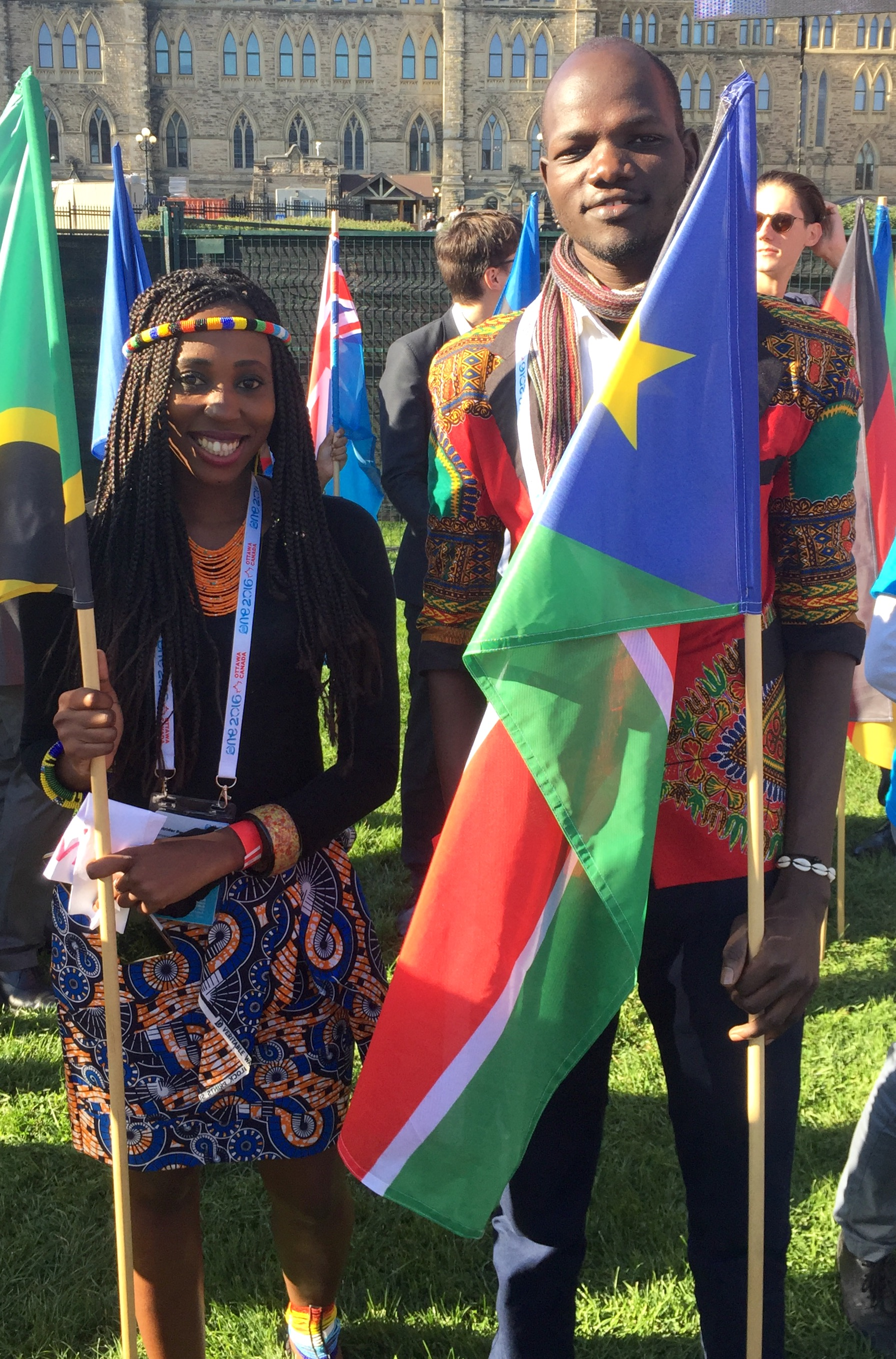 James holding the South Sudanese flag at the One Young World Summit in Ottawa, Canada, 2016