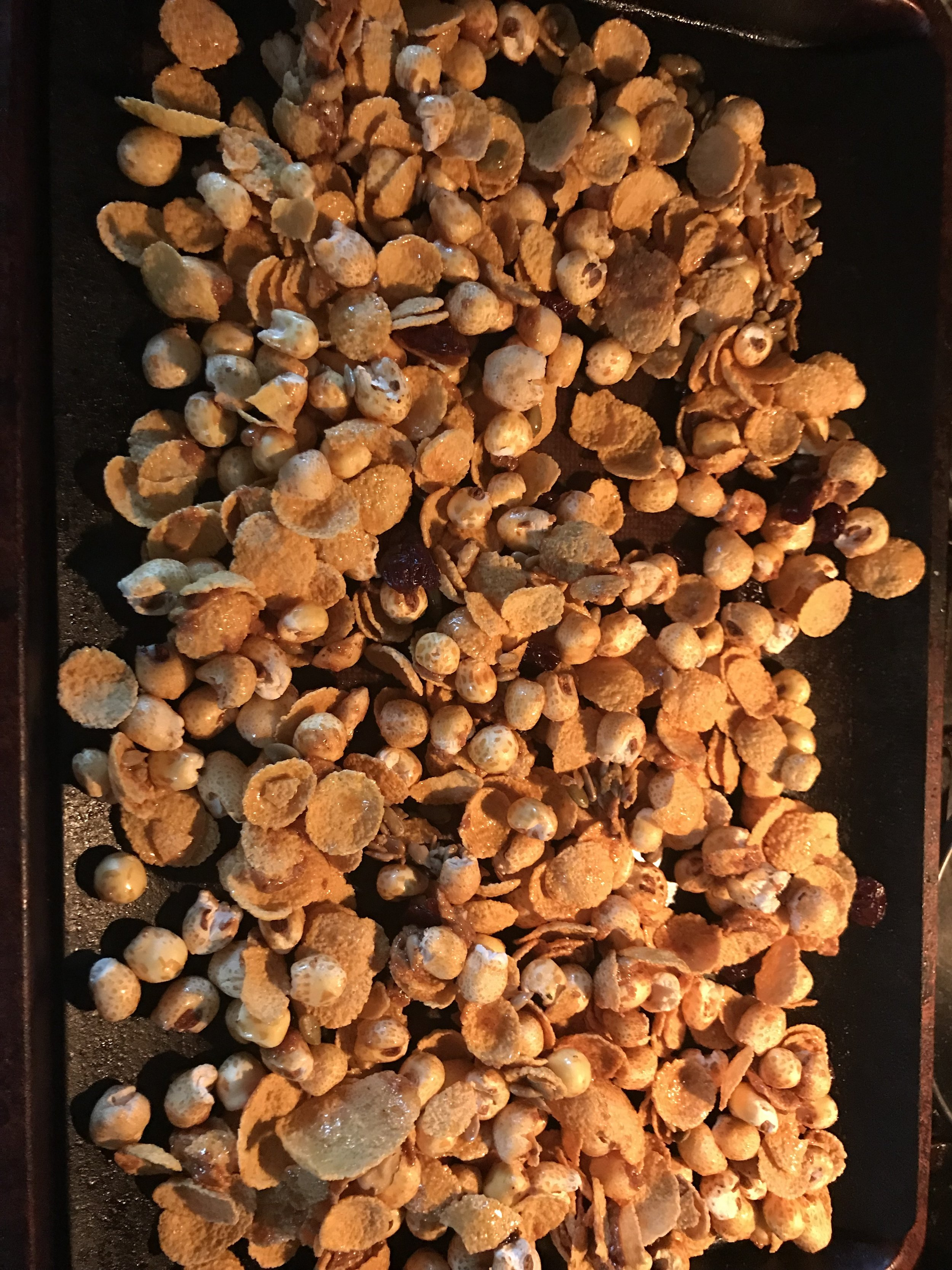 Homemade Corn Flake Granola: corn puffs, corn flakes, almond butter, maple syrup, sunflower seeds, dried cherries, cinnamon. BAKE at 350 degrees for 15 minutes or until golden. -
