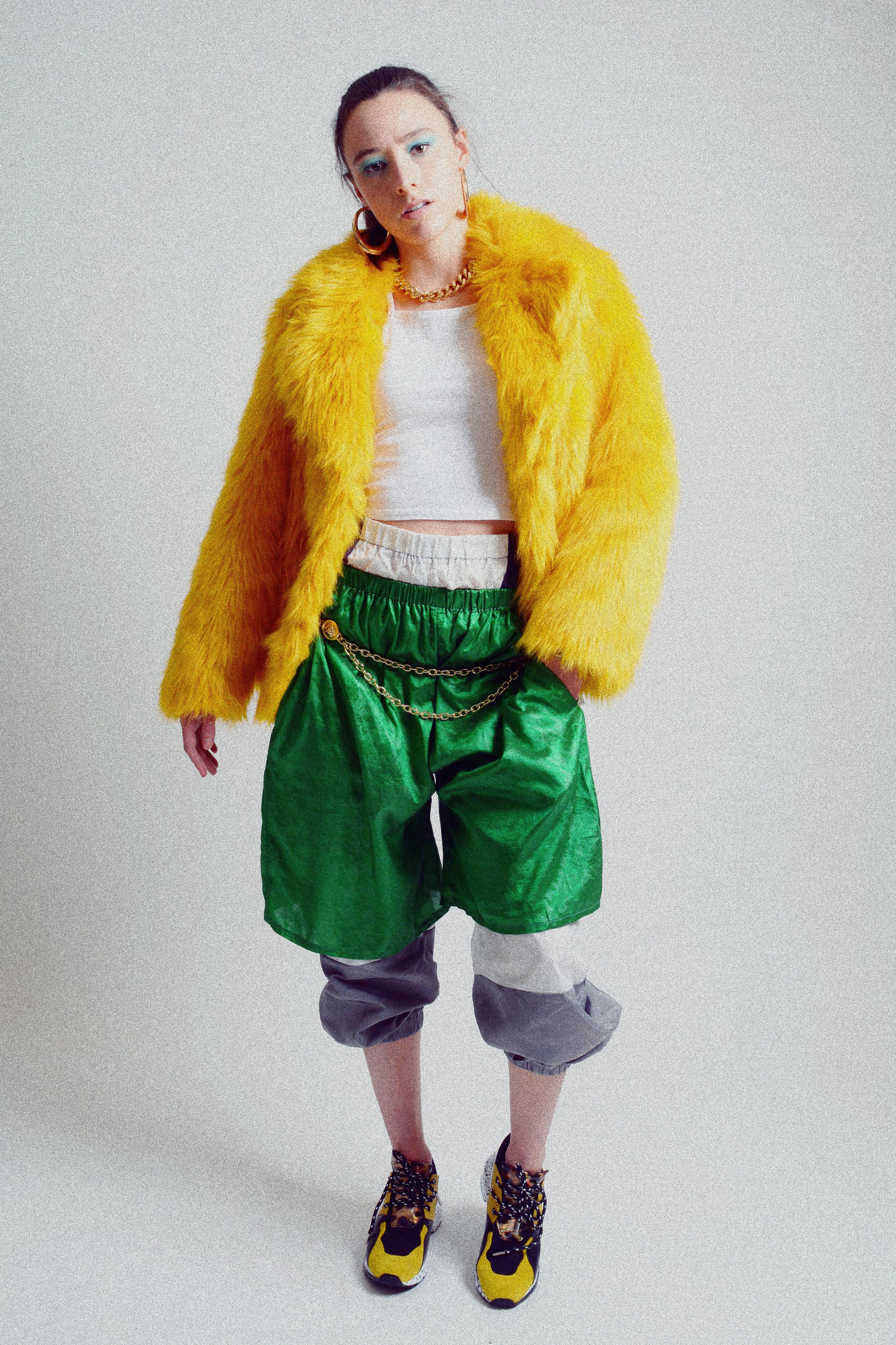 Jacket: TopShop Tank top: H&M Pants: Fashionnova Shorts: Alex S. Yu Shoes: Steve Madden Chain Belt: TopShop Necklace: H&M Earrings and bracelet: Aldo