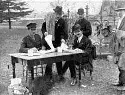 Sgt Foster and helpers allocating trees (Weekly Courier July 1918).