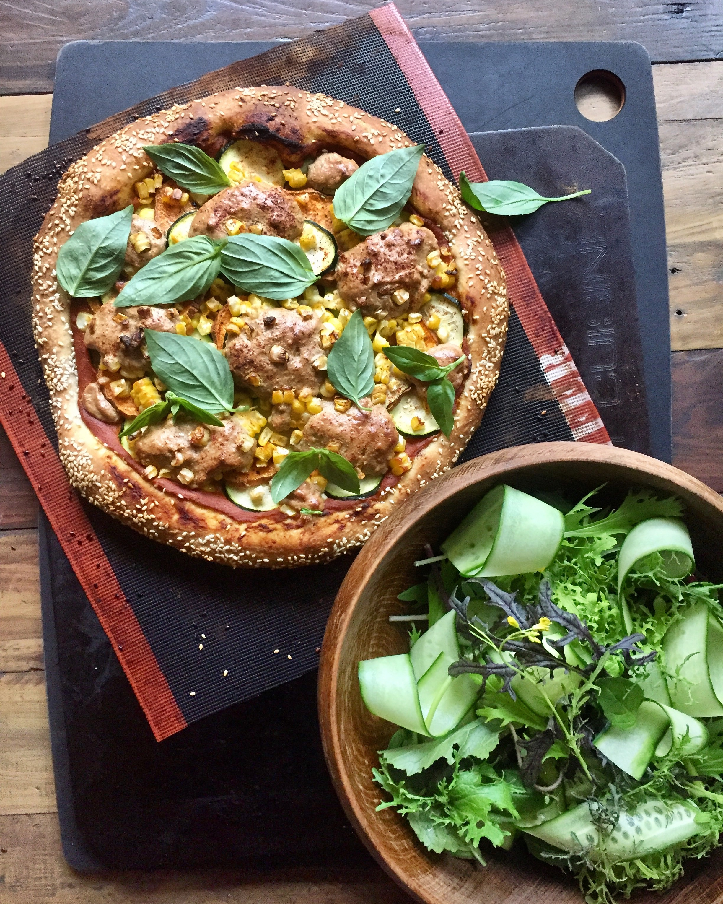 Marinara sauce, zucchini, sweetcorn, cashew mozzarella and basil pizza with a verdant salad makes for scrumptious dinner for two.