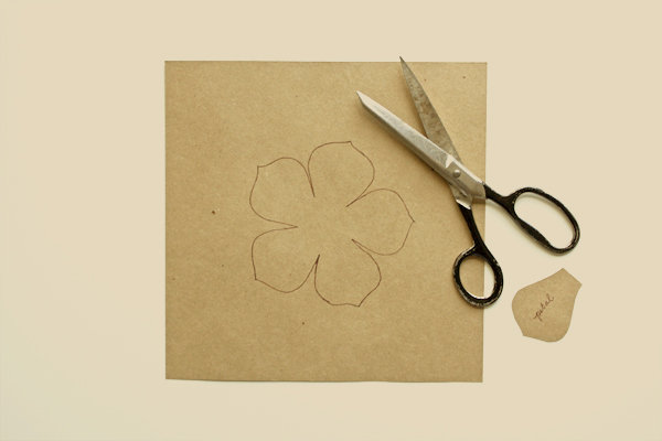 Image showing a full flower shape on a paper and a scissor
