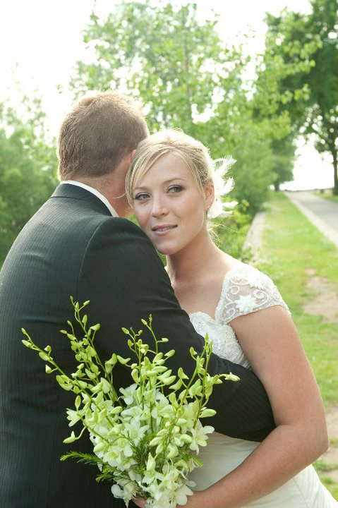 bride holding a flower bouquet and a groom