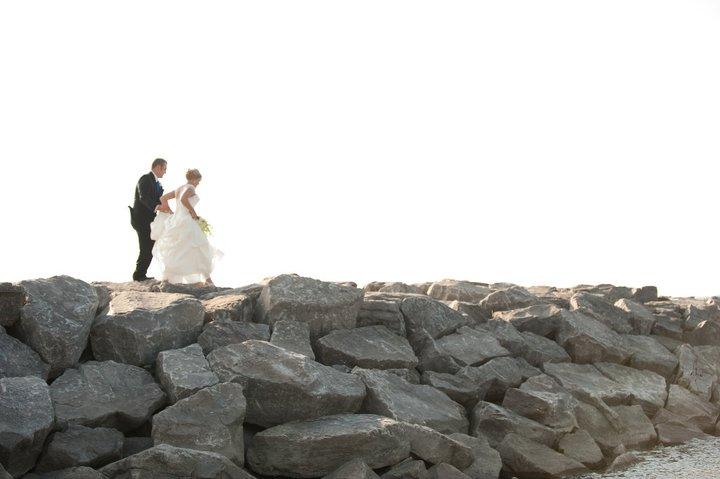 portrait of a bride and broom on a seashore