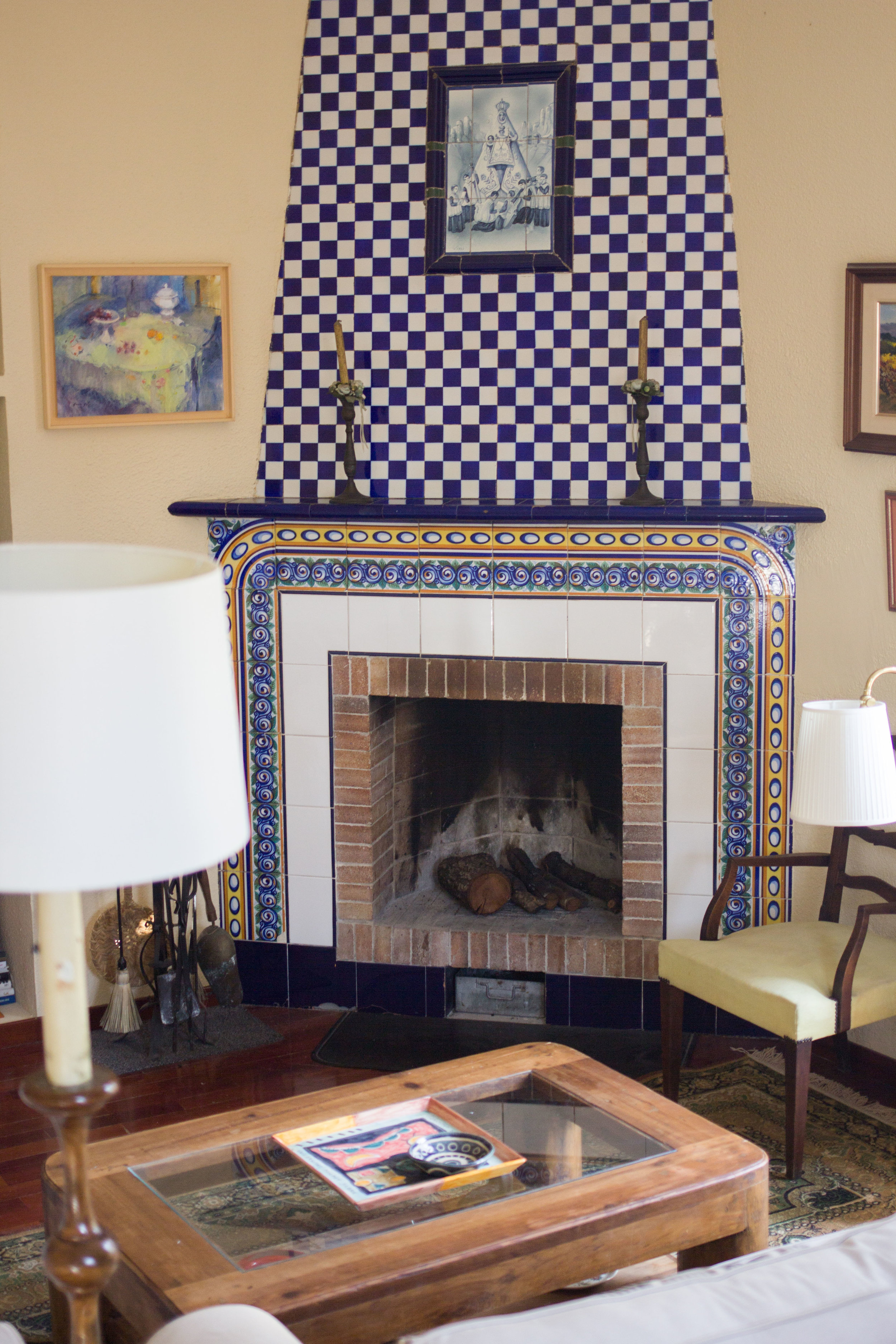 traditional Spanish painted porcelain fireplace in the living room