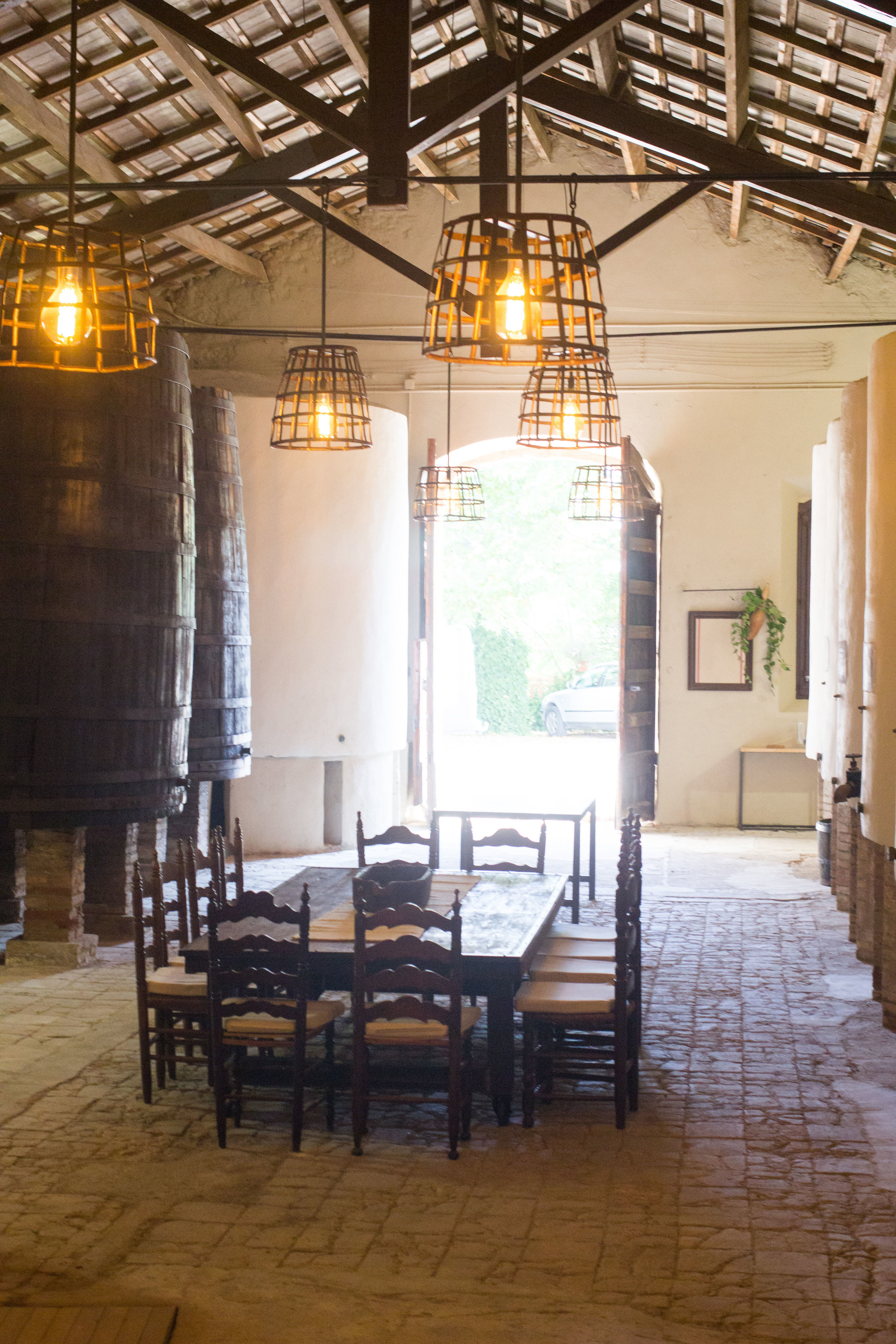 Sunlight floods the ambient wine cellar room with original stone floor