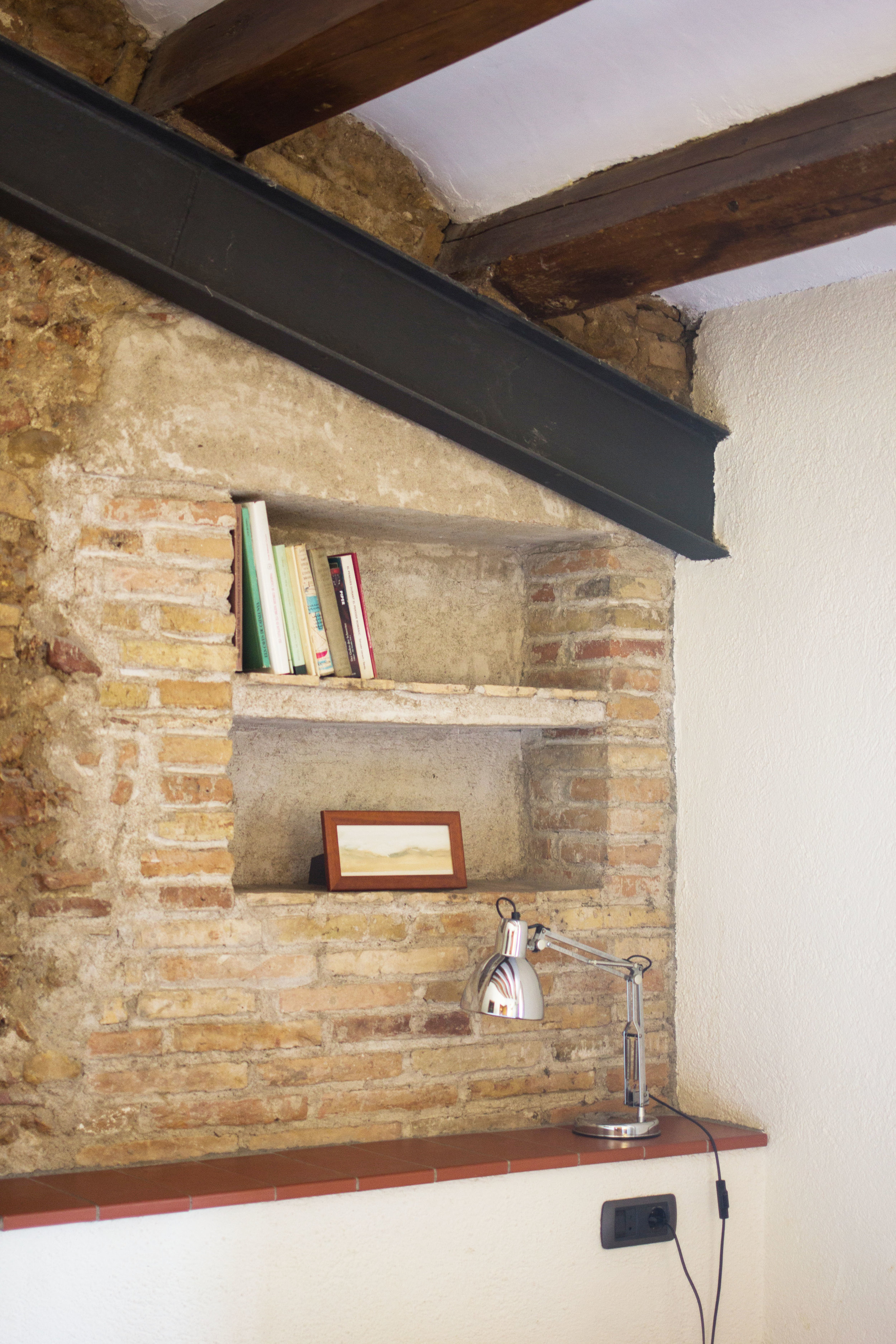 close up of the built in shelves with books and artwork