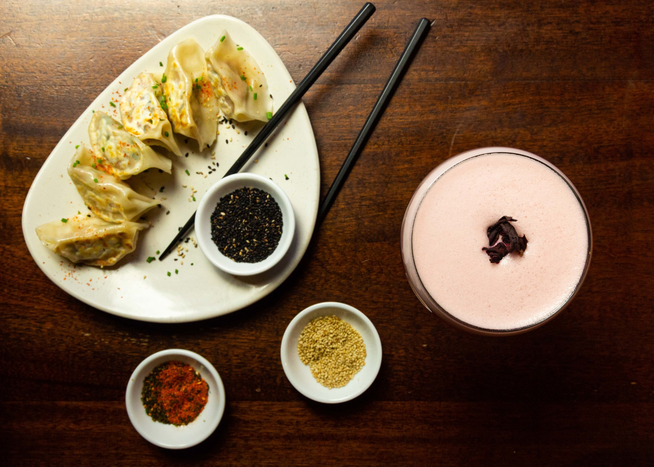 Yasai (vegetable) Gyoza pictured with a house cocktail. Regularly served with a sweet and tangy gyoza sauce
