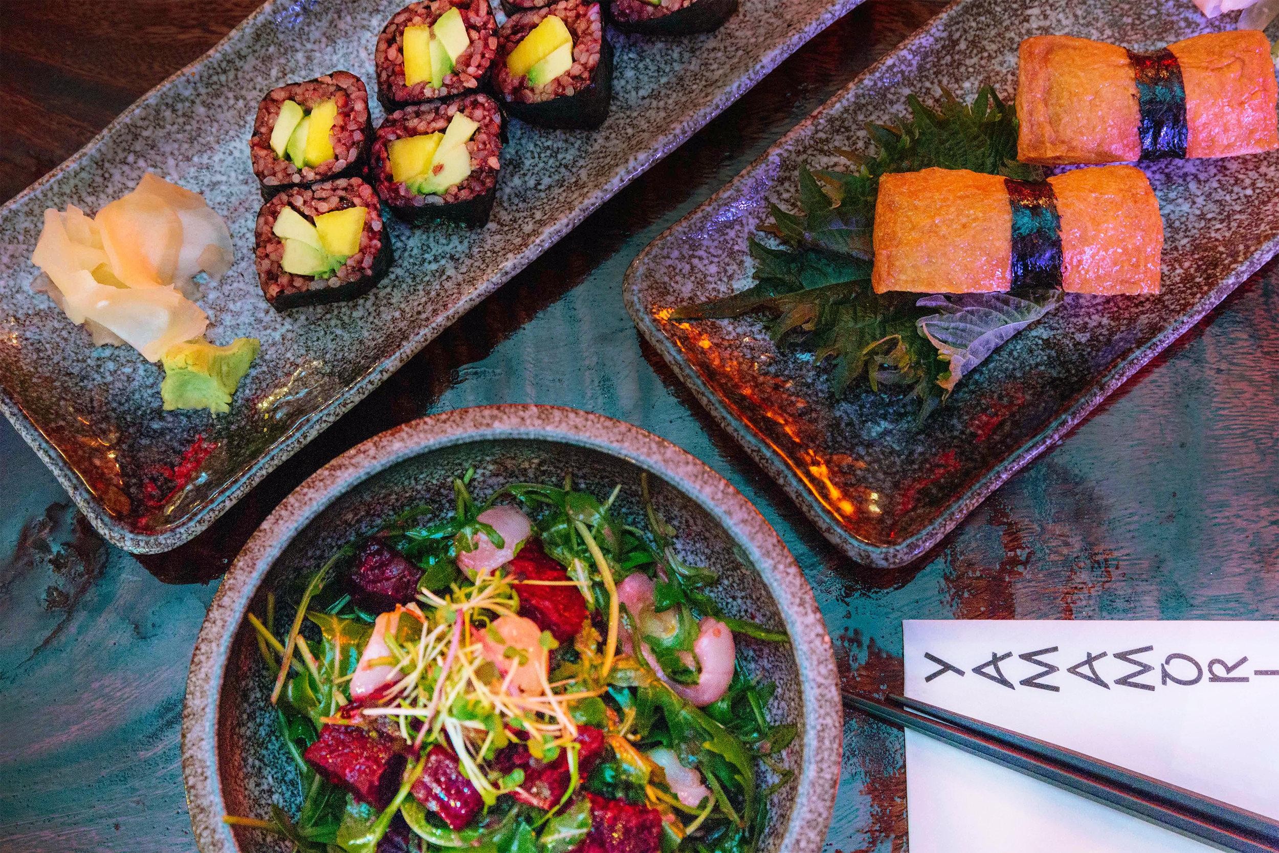 Clockwise from top left: Avocado and Mango Nori roll, Inari Nigiri, and Beetroot and Lychee Salad
