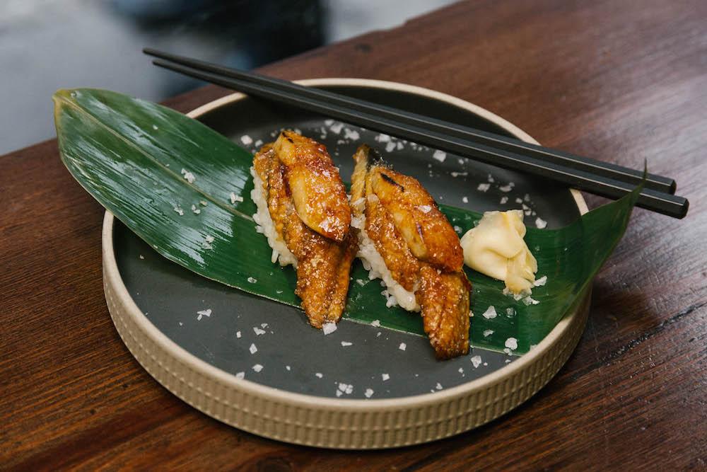 The final dish, garnished with rock salt and pickled ginger on banana leaf