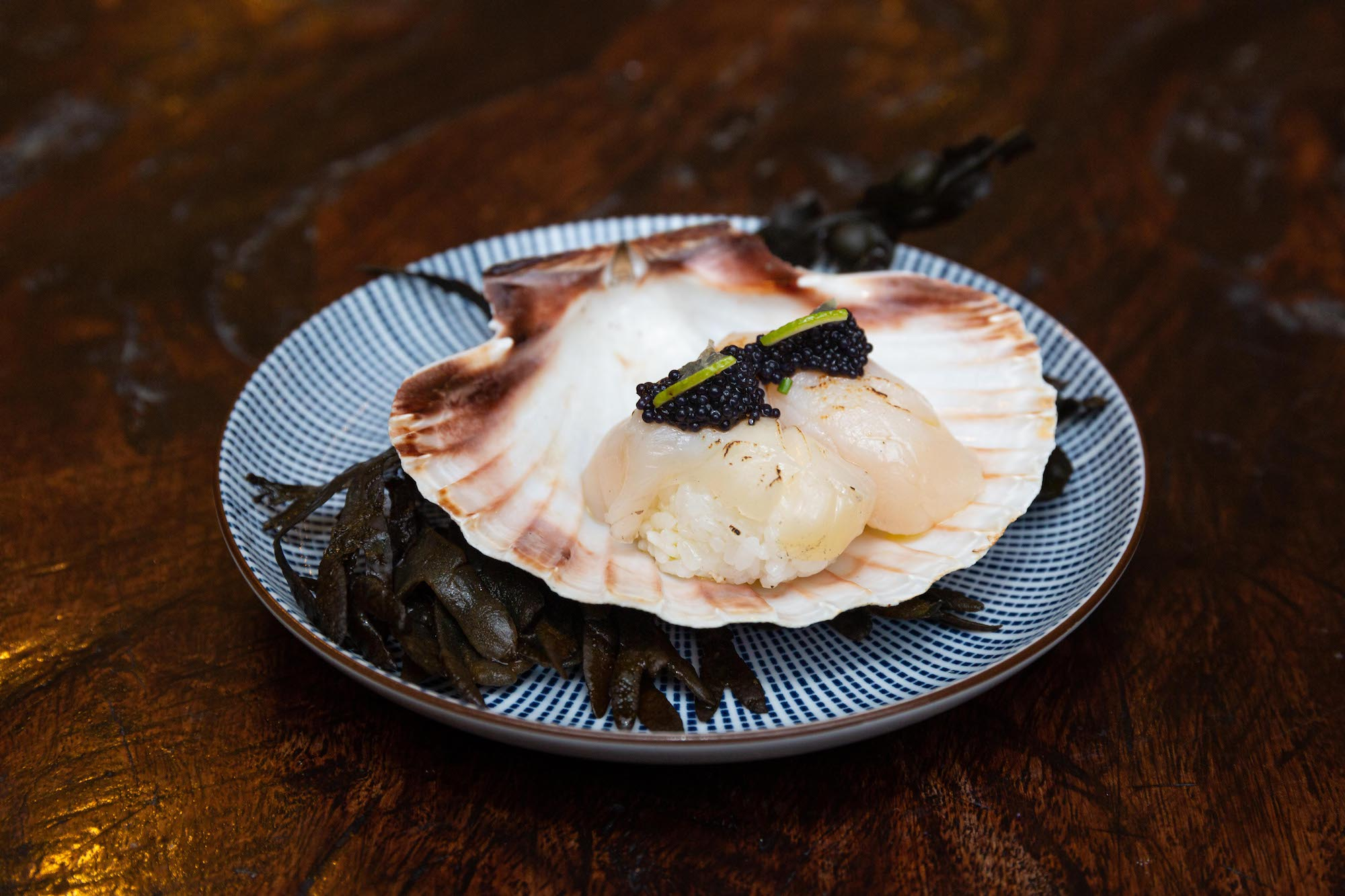 Torched scallop sushi with caviar